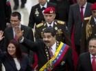 El presidente venezolano Nicolás Maduro y la primera dama Cilia Flores saludan a su llegada a la Asamblea Nacional para una sesión especial para conmemorar el Día de la Independencia del país, en Caracas, Venezuela.