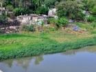 Barrios improvisados son la principal fuente de contaminación del río Yaque.