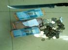 Dinero y arma ocupada al haitiano.