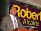 Elpidio Báez habla durante el acto en un hotel de esta capital.