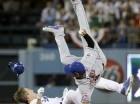 El panameño Rubén Tejada, de los Mets de Nueva York, cae descompuesto tras ser embestido por Chase Utley, de los Dodgers de Los Ángeles, en el segundo juego de la serie divisional de la Liga Nacional.