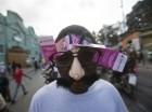 Un partidario del candidato oficialista a la presidencia Jovenel Moise asiste a un acto el 5 de febrero de 2016 en Puerto Príncipe, Haití. los principales dirigentes haitianos han llegado a un acuerdo para formar un gobierno provisional, un día antes d