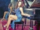 La cantante Leisha Díaz se promueve a ritmo de bachata.