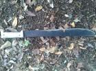 Machete utilizado por el agresor Cristino Rosario Tejada antes de suicidarse.